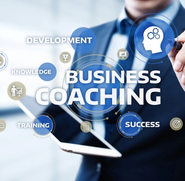 A small business coach works on a business plan.